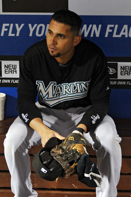 PHILADELPHIA, PA - SEPTEMBER 15: Omar Infante #13 of the Florida Marlins sits in the dugout after losing 2-1 to the Philadelphia Phillies in extra innings at Citizens Bank Park on September 15, 2011 in Philadelphia, Pennsylvania. (Photo by Drew Hallowell/