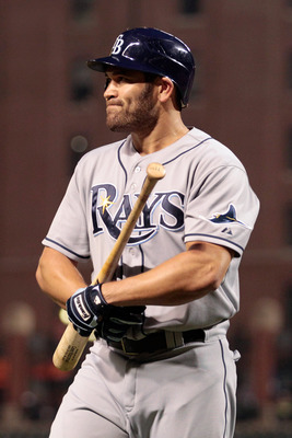 BALTIMORE, MD - SEPTEMBER 14:  Johnny Damon #22 of the Tampa Bay Rays walks back to the dugout after striking out swinging against the Baltimore Orioles during the second inning at Oriole Park at Camden Yards on September 14, 2011 in Baltimore, Maryland.