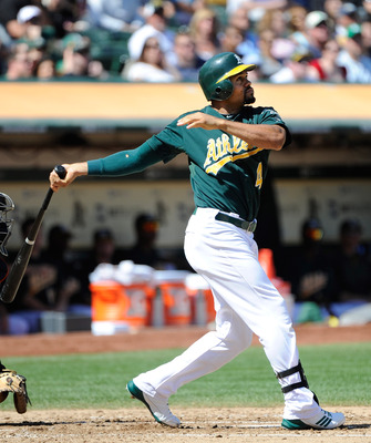 OAKLAND, CA - SEPTEMBER 17: Coco Crisp #4 of the Oakland Athletics hits an RBI single driving in Kurt Suzuki #8  against the Detroit Tigers in the second inning during an MLB baseball game at O.co Coliseum on September 17, 2011 in Oakland, California.  (P