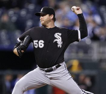 KANSAS CITY, MO - SEPTEMBER 15:   Mark Buehrle #56 of the Chicago White Sox throws in the first inning during a game against the Kansas City Royals at Kauffman Stadium on September 15, 2011 in Kansas City, Missouri. (Photo by Ed Zurga/Getty Images)