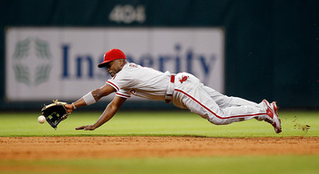 HOUSTON - SEPTEMBER 12:  Shortstop Jimmy Rollins #11 of the Philadelphia Phillies makes a diving attempt on a ball hit in the hole by Brett Myers of the Houston Astros at Minute Maid Park on September 12, 2011 in Houston, Texas.  (Photo by Bob Levey/Getty