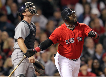 BOSTON, MA - SEPTEMBER 16:  John Jaso #28 of the Tampa Bay Rays and David Ortiz #34 of the Boston Red Sox watches the flight of a fly ball hit by Ortiz in the fifth inning at Fenway Park September 16, 2011 in Boston, Massachusetts. (Photo by Jim Rogash/Ge
