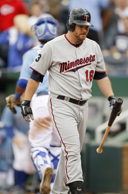 KANSAS CITY, MO - SEPTEMBER 14:   Jason Kubel #16 of the Minnesota Twins walks to the dugout after striking out in the seventh inning during a game against the Kansas City Royals at Kauffman Stadium on September 14, 2011 in Kansas City, Missouri. (Photo b