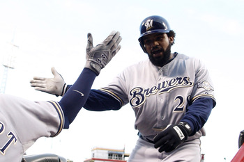 CINCINNATI, OH - SEPTEMBER 16:  Prince Fielder #28 of the Milwaukee Brewers receives congratulations after connecting for his 33rd home run during the game against the Cincinnati Reds on September 16, 2011 at Great American Ball Park in Cincinnati, Ohio.