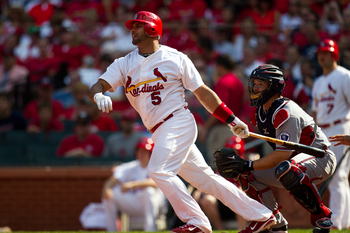 ST. LOUIS, MO - SEPTEMBER 11: Albert Pujols #5 of the St. Louis Cardinals follows through his swing during the game at Busch Stadium on September 11, 2011 in St. Louis, Missouri. St. Louis defeated the Atlanta 6-3. (Photo by David Welker/Getty Images)