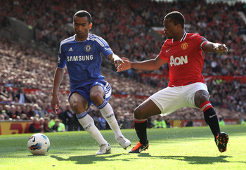 MANCHESTER, ENGLAND - SEPTEMBER 18:   Jose Bosingwa of Chelsea competes with Patrice Evra of Manchester United during the Barclays Premier League match between Manchester United and Chelsea at Old Trafford on September 18, 2011 in Manchester, England. (Ph