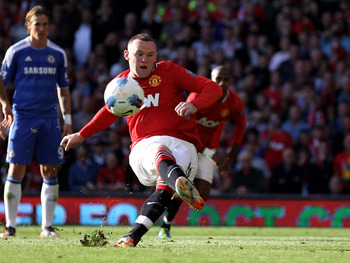 MANCHESTER, ENGLAND - SEPTEMBER 18:  Wayne Rooney of Manchester United slips as he takes and subsequently misses a penalty kick during the Barclays Premier League match between Manchester United and Chelsea at Old Trafford on September 18, 2011 in Manches