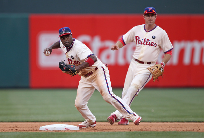 PHILADELPHIA - JULY 25: Shortstop Jimmy Rollins #11 of the Philadelphia Phillies throws to first base during a game against the San Diego Padres at Citizens Bank Park on July 25, 2011 in Philadelphia, Pennsylvania. The Padres won 5-4. (Photo by Hunter Mar