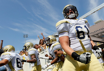 ATLANTA, GA - SEPTEMBER 17:  Phil Smith #61 of the Georgia Tech Yellow Jackets screams as he enters the field to face the Kansas Jayhawks at Bobby Dodd Stadium on September 17, 2011 in Atlanta, Georgia.  (Photo by Kevin C. Cox/Getty Images)