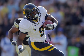 BOULDER, CO - SEPTEMBER 10:  Tailback C.J. Anderson #9 of the California Golden Bears rushes for a touchdown against the Colorado Buffaloes to give the Bears a 30-27 lead in the fourth quarter at Folsom Field on September 10, 2011 in Boulder, Colorado. Th