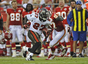 KANSAS CITY, MO - AUGUST 12:  Running back LeGarrette Blount #27 of the Tampa Bay Buccaneers rushes past linebacker Pierre Walters #97 of the Kansas City Chiefs during the first half on August 12, 2011 at Arrowhead Stadium in Kansas City, Missouri.  (Phot
