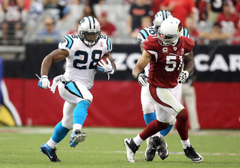 GLENDALE, AZ - SEPTEMBER 11:  Runningback Jonathan Stewart #28 of the Carolina Panthers rushes the football during the NFL season opening game against the Arizona Cardinals at the University of Phoenix Stadium on September 11, 2011 in Glendale, Arizona. T
