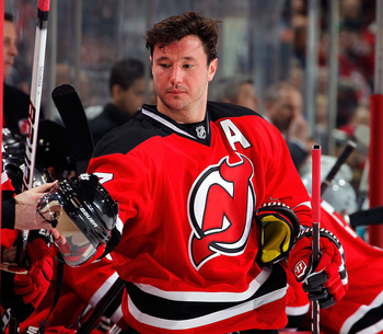 NEWARK, NJ - FEBRUARY 11: Ilya Kovalchuk #17 of the New Jersey Devils reaches to take his helmet in a timeout during an NHL hockey game against the San Jose Sharks on February 11, 2011 at the Prudential Center in Newark, New Jersey. (Photo by Paul Bereswi