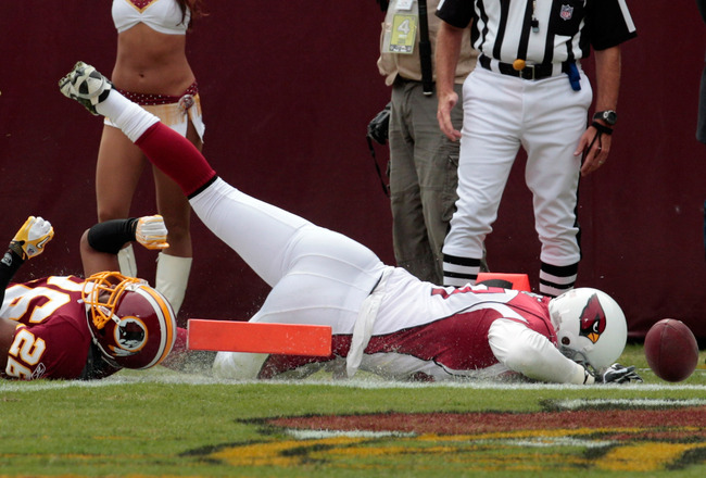 LANDOVER, MD - SEPTEMBER 18:  Tight end Jeff King #87 of the Arizona Cardinals scores a touchdown in front of defender Josh Wilson #26 of the Washington Redskins during the first half at FedExField on September 18, 2011 in Landover, Maryland.  (Photo by R