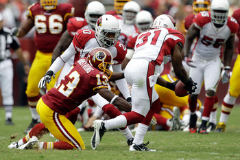 LANDOVER, MD - SEPTEMBER 18: Defender Richard Marshall #31 of the Arizona Cardinals intercepts a pass intended for wide receiver Anthony Armstrong #13 of the Washington Redskins during the first half at FedExField on September 18, 2011 in Landover, Maryla