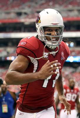 GLENDALE, AZ - SEPTEMBER 11:  Wide receiver Larry Fitzgerald #11 of the Arizona Cardinals runs off the field during the NFL season opening game against the Carolina Panthers at the University of Phoenix Stadium on September 11, 2011 in Glendale, Arizona.