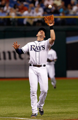 ST. PETERSBURG, FL - SEPTEMBER 09:  Infielder Evan Longoria #3 of the Tampa Bay Rays catches a fly ball against the Boston Red Sox during the game at Tropicana Field on September 9, 2011 in St. Petersburg, Florida.  (Photo by J. Meric/Getty Images)