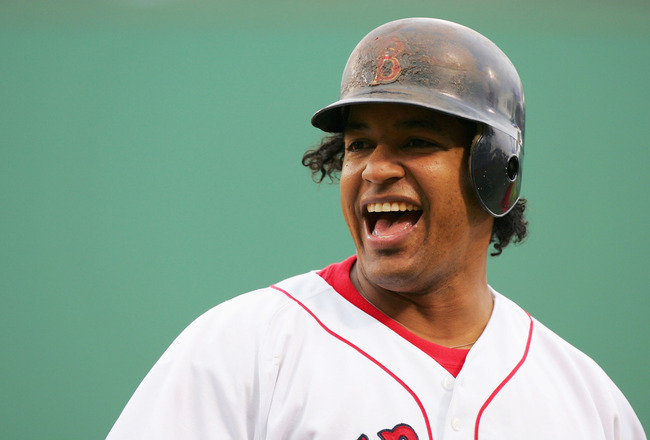 BOSTON - JULY 24:  Manny Ramirez #24 of the Boston Red Sox smiles even though he made the last out in the fifth inning against the New York Yankees on July 24, 2004 at Fenway Park in Boston, Massachusetts. The Red Sox won 11-10.  (Photo by Ezra Shaw/Getty