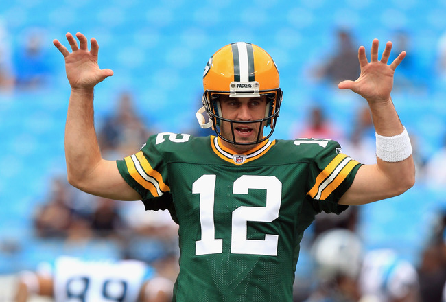 CHARLOTTE, NC - SEPTEMBER 18:   Aaron Rodgers #12 of the Green Bay Packers warms up before the game against the Carolina Panthers at Bank of America Stadium on September 18, 2011 in Charlotte, North Carolina.  (Photo by Streeter Lecka/Getty Images)