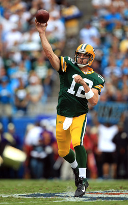 CHARLOTTE, NC - SEPTEMBER 18:  Aaron Rodgers #12 of the Green Bay Packers drops back to pass against the Carolina Panthers during their game at Bank of America Stadium on September 18, 2011 in Charlotte, North Carolina.  (Photo by Streeter Lecka/Getty Ima