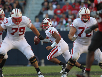 CHICAGO, IL - SEPTEMBER 17:  Russell Wilson #16 of the Wisconsin Badgers looks for a receiver as teammates Ryan Groy #79 and Travis Frederick #72 move to block against the Northern Illinois Huskies at Soldier Field on September 17, 2011 in Chicago, Illino
