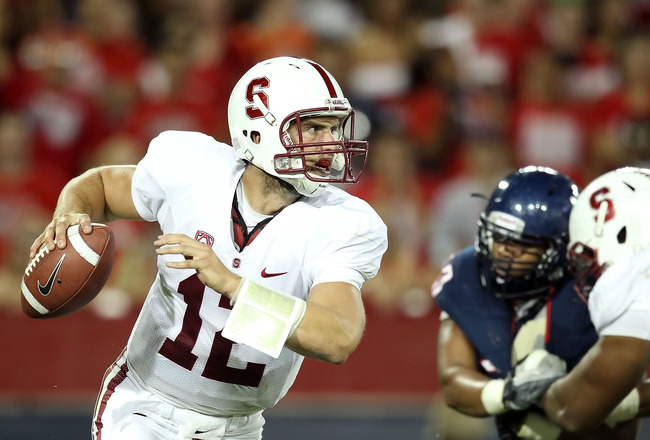 TUCSON, AZ - SEPTEMBER 17:  Quarterback Andrew Luck #12 of the Stanford Cardinal scrambles to pass during the college football game against the Arizona Wildcats at Arizona Stadium on September 17, 2011 in Tucson, Arizona.  The Cardinal defeated the Wildca