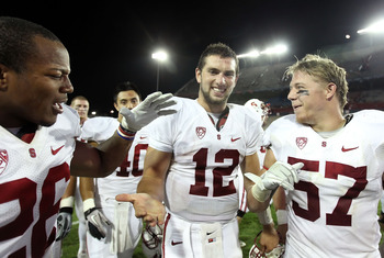 TUCSON, AZ - SEPTEMBER 17:  Quarterback Andrew Luck #12 (C) of the Stanford Cardinal celebrates with teammates Delano Howell #26 and Max Bergen #57 after defeating the Arizona Wildcats in the college football game at Arizona Stadium on September 17, 2011
