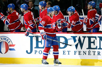 MONTREAL- NOVEMBER 27:  Andrei Kostitsyn #46 of the Montreal Canadiens celebrates his first period goal with teammates during the NHL game against the Buffalo Sabres at the Bell Centre on November 27, 2010 in Montreal, Quebec, Canada.  (Photo by Richard W