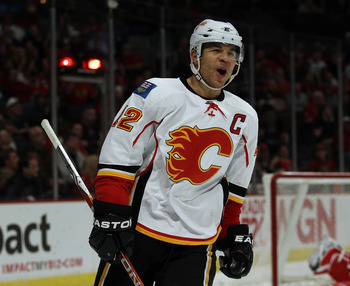 CHICAGO, IL - MARCH 02: Jarome Iginla #12 of the Calgary Flames celebrates a 3rd period goal by teammate Rene Bourque against the Chicago Blackhawks at the United Center on March 2, 2011 in Chicago, Illinois. The Blackhawks defeated the Flames 6-4. (Photo