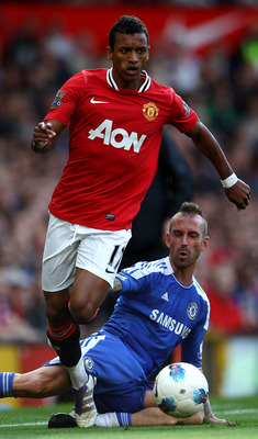 MANCHESTER, ENGLAND - SEPTEMBER 18:  Nani of Manchester United goes past Raul Meireles of Chelsea during the Barclays Premier League match between Manchester United and Chelsea at Old Trafford on September 18, 2011 in Manchester, England. (Photo by Clive