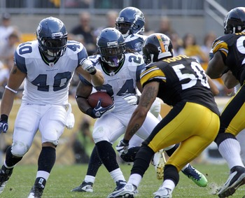 PITTSBURGH, PA - SEPTEMBER 18:   Marshawn Lynch #24 of the Seattle Seahawks carries the ball against the Pittsburgh Steelers during the game on September 18, 2011 at Heinz Field in Pittsburgh, Pennsylvania.  The Steelers defeated the Seahawks 24-0.  (Phot