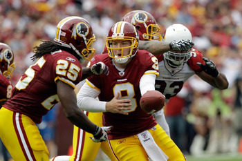 LANDOVER, MD - SEPTEMBER 18: Quarterback  Rex Grossman #8 of the Washington Redskins hands the ball off to running back  Tim Hightower #25 during the first half against the Arizona Cardinals at FedExField on September 18, 2011 in Landover, Maryland.  (Pho