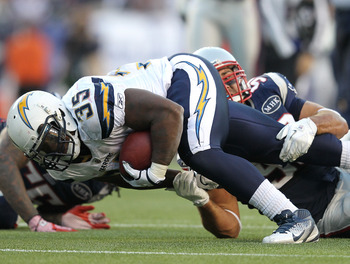 FOXBORO, MA -  SEPTEMBER 18:   Rob Ninkovich #50 of the New England Patriots stops  Mike Tolbert #35 of the San Diego Chargers in the second half at Gillette Stadium on September 18, 2011 in Foxboro, Massachusetts. (Photo by Jim Rogash/Getty Images)