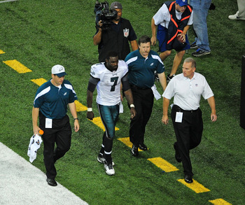 ATLANTA - SEPTEMBER 18: Michael Vick #7 of the Philadelphia Eagles heads off the field after being injured against the Atlanta Falcons at the Georgia Dome on September 18, 2011 in Atlanta, Georgia. (Photo by Scott Cunningham/Getty Images)