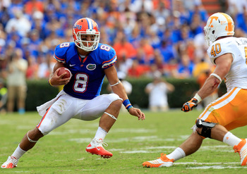 GAINESVILLE, FL - SEPTEMBER 17:  Trey Burton #8 of the Florida Gators attempts turnover run past linebacker Austin Johnson #40 of the Tennessee Volunteers  during a game at Ben Hill Griffin Stadium on September 17, 2011 in Gainesville, Florida.  (Photo by