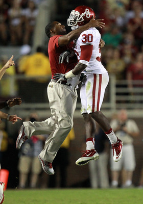 TALLAHASSEE, FL - SEPTEMBER 17:  Javon Harris #30 of the Oklahoma Sooners celebrates a pass interception against the Florida State Seminoles at Doak Campbell Stadium on September 17, 2011 in Tallahassee, Florida.  (Photo by Ronald Martinez/Getty Images)