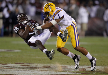 STARKVILLE, MS - SEPTEMBER 15:  Safety Eric Reid #1 of the LSU Tigers knocks running back Vick Ballard #28 of the Mississippi State Bulldogs off his feet in the fourth quarter on September 15, 2011 at Davis Wade stadium in Starkville, Mississippi. (Photo
