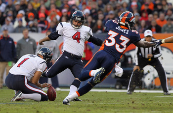 DENVER - DECEMBER 26:  Place kicker Neil Rackers #4 of the Houston Texas kicks a 57 yard field goal from the hold of Matt Turk #1 as Nate Jones #33 of the Denver Broncos looks to block the third quarter kick at INVESCO Field at Mile High on December 26, 2