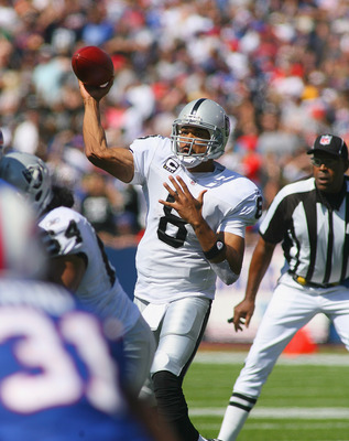 ORCHARD PARK, NY - SEPTEMBER 18: Jason Campbell #8 of the Oakland Raiders throws a pass against the Buffalo Bills at Ralph Wilson Stadium on September 18, 2011 in Orchard Park, New York.  (Photo by Rick Stewart/Getty Images)