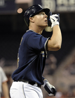SAN DIEGO, CA - SEPTEMBER 6:  Nick Hundley #4 of the San Diego Padres points skyward after hitting a solo home run during the third inning of a baseball game against the San Francisco Giants at Petco Park on September 6, 2011 in San Diego, California.  (P