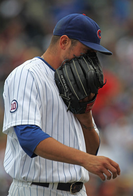 CHICAGO, IL - SEPTEMBER 05: Starting pitcher Matt Garza #17 of the Chicago Cubs talks into his glove after leaving the game against the Cincinnati Reds at Wrigley Field on September 5, 2011 in Chicago, Illinois. The Cubs defeated the Reds 4-3. (Photo by J