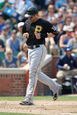 CHICAGO, IL - SEPTEMBER 2: Neil Walker #18 of the Pittsburgh Pirates steps on home plate to score a run during the game against the Chicago Cubs at Wrigley Field on September 2, 2011 in Chicago, Illinois.  (Photo by Scott Boehm/Getty Images)