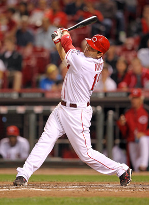 CINCINNATI, OH - SEPTEMBER 14:  Joey Votto #19 of the Cincinnati Reds hits the ball during the game against the Chicago Cubs at Great American Ball Park on September 14, 2011 in Cincinnati, Ohio.  (Photo by Andy Lyons/Getty Images)