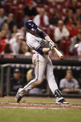 CINCINNATI, OH - SEPTEMBER 17:   Ryan Braun #8 of the Milwaukee Brewers connects for a three-run home run during the game against the Cincinnati Reds on September 17, 2011 at Great American Ball Park in Cincinnati, Ohio.  The Brewers defeated the Reds 10-