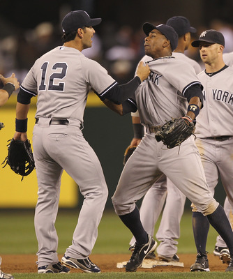 SEATTLE - SEPTEMBER 12:  Eric Chavez #12 of the New York Yankees celebrates with Curtis Granderson #14 after defeating the Seattle Mariners 9-3 at Safeco Field on September 12, 2011 in Seattle, Washington. (Photo by Otto Greule Jr/Getty Images)