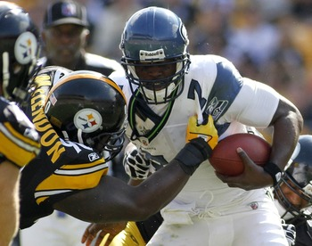 PITTSBURGH, PA - SEPTEMBER 18:   Tavaris Jackson #7 of the Seattle Seahawks is sacked by  Steve McLendon #90 of the Pittsburgh Steelers during the game on September 18, 2011 at Heinz Field in Pittsburgh, Pennsylvania.  The Steelers defeated the Seahawks 2