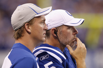 INDIANAPOLIS, IN - AUGUST 26: Peyton Manning (L) and Kerry Collins #5 of the Indianapolis Colts look on during the first half of an NFL preseason game against the Green Bay Packers at Lucas Oil Stadium on August 26, 2011 in Indianapolis, Indiana. (Photo b