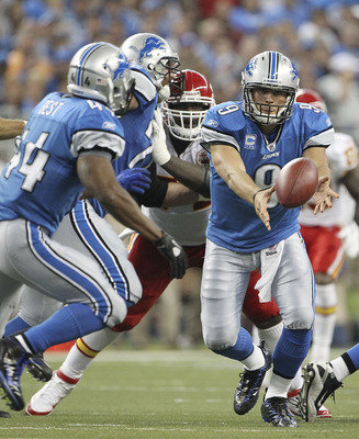 DETROIT, MI - SEPTEMBER 18: Matthew Stafford #9 of the Detroit Lions pitches the ball to Jahvid Best #44 during the fourth quarter of the game at Ford Field on September 18, 2011 in Detroit, Michigan. The Lions defeated the Chiefs 48-3.  (Photo by Leon Ha