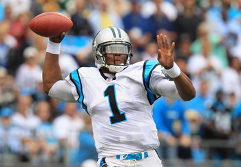 CHARLOTTE, NC - SEPTEMBER 18:  Cam Newton #1 of the Carolina Panthers drops back to pass against the Green Bay Packers during their game at Bank of America Stadium on September 18, 2011 in Charlotte, North Carolina.  (Photo by Streeter Lecka/Getty Images)