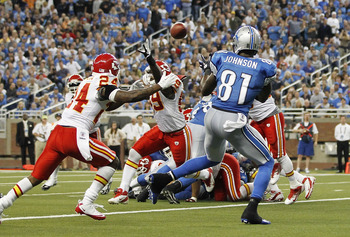DETROIT, MI - SEPTEMBER 18: Calvin Johnson #81 of the Detroit Lions scores on a 1 yard pass in the third quarter from Matthew Stafford #9 as Brandon Lewis #24 of the Kansas CIty Chiefs defends during the game at Ford Field on September 18, 2011 in Detroit